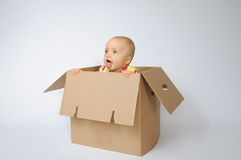 Child in the box. Beutiful child sits in the box Royalty Free Stock Photo