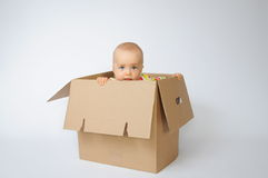 Child in the box Stock Images