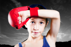 Child with boxing glove stock photo