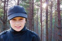 Child boy backlight portrait pine forest. Outdoor Stock Photo