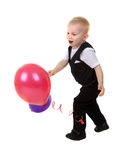 Child boy with balloons. Little nice boy with balloons isolated on white background Royalty Free Stock Photo