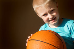 Child (boy) with basketball Stock Image