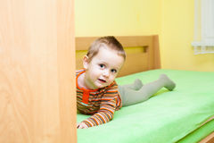 Child boy on bed Stock Images