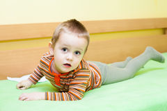 Child boy on bed Royalty Free Stock Photo