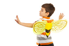 Child boy with bee wings. Trying to fly isolated on white background Royalty Free Stock Photography