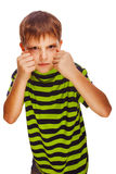 Child boy blond bully angry bad aggressive fights. In striped green shirt isolated on white background royalty free stock photography