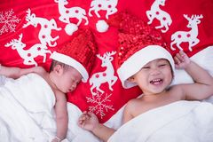 Child boy brother and sister girl newborn baby infant have santa royalty free stock image