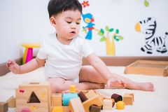 Child boy building playing toy blocks wood. Indoors room royalty free stock photos