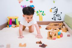 Child boy building playing toy blocks wood. Indoors room stock photos