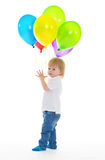 Child boy with bunch of colourful balloons Stock Images