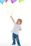 Child boy with bunch of colourful balloons Royalty Free Stock Photos