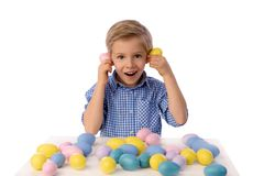Child and Easter. Smiling blond boy, 6 years old, is holding a yellow chickens. Child, boy celebrating Easter. 5 years old smiling boy celebrate Easter, painting royalty free stock images
