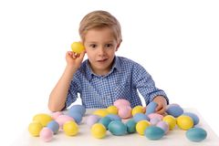 Child and Easter. Smiling blond boy, 6 years old, is holding a yellow chickens. Child, boy celebrating Easter. 5 years old smiling boy celebrate Easter, painting stock photo