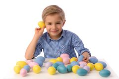 Child and Easter. Smiling blond boy, 6 years old, is holding a yellow chickens. Child, boy celebrating Easter. 5 years old smiling boy celebrate Easter, painting stock image