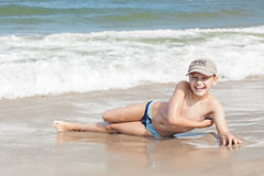 Child boy cheerful on beach Stock Image