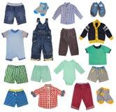 Child boy clothes set isolated on white. Colorful child boy clothes set isolated on white. Collage of male kid clothing on white background stock images