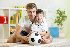 Child boy with dad play football at home Royalty Free Stock Photography