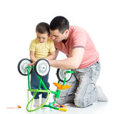 Child boy and daddy fixing bisycle Stock Image