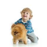 Child boy with dog spitz, isolated on white background. Child boy hugging dog spitz, isolated on white background royalty free stock photography