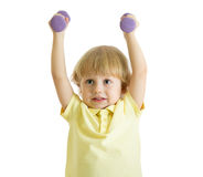 Child boy is doing exercises to develop muscles isolated on white background Stock Photography