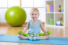 Child boy doing fitness exercises royalty free stock photos