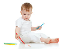 Child boy drawing with color pencils on the floor Stock Photos