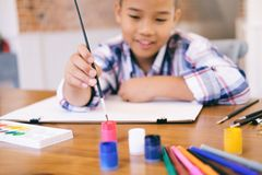 Child boy drawing picture at home. royalty free stock photos