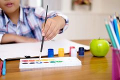 Child boy drawing picture at home stock photos