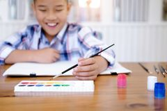 Child boy drawing picture at home stock images