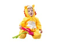 Child boy,dressed in lion carnival suit, isolated on white background. Baby zodiac - sign Leo. The concept of childhood and holiday stock photography