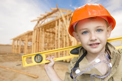 Child Boy Dressed Up as Handyman in Front of House Framing Royalty Free Stock Photo