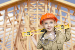 Child Boy Dressed Up as Handyman in Front of House Framing Royalty Free Stock Photos