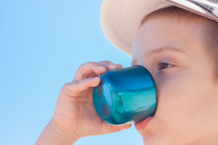Child boy drink water outdoor. Child boy drinking water close up outdoor Stock Images