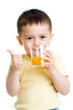 Child boy drinking juice  and showing thumb up Stock Photography