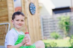 Child boy drinking strawberry smoothie Royalty Free Stock Photos