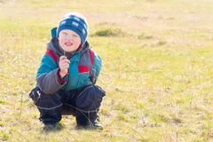 Child (boy) on dry grass (field) Stock Photo