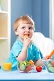 Child boy eating healthy food at home interior Royalty Free Stock Photo