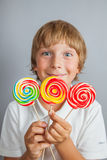Child boy eating lollipop. Isolated Royalty Free Stock Image