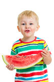 Child boy eating watermelon isolated Royalty Free Stock Photography