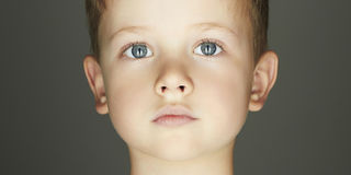 Child boy face. Handsome funny kid looking at camera stock images