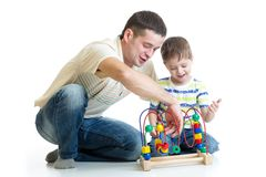 Child  boy and father playing together Stock Image