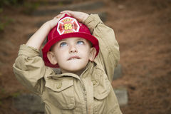 Child Boy with Fireman Hat Playing Outside Royalty Free Stock Images