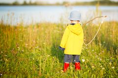 Child boy with fishing rod ready for fishing.  Stock Photos