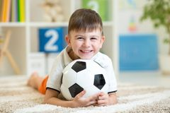 Child boy with football at home. Smiling child boy with football at home royalty free stock image