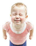 Child boy funny smiling and narrow closed eyes, ha. Ppy baby dreaming wishes, isolated over white background Royalty Free Stock Photography