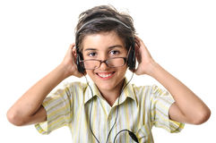 Child boy in glasses with headphones Royalty Free Stock Images
