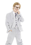 Child boy in glasses and suit, isolated over white background Royalty Free Stock Photography