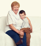 Child boy and grandmother on white, happy family concept Stock Images