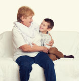 Child boy and grandmother on white, happy family concept Royalty Free Stock Photos