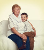 Child boy and grandmother on white, happy family concept Royalty Free Stock Images